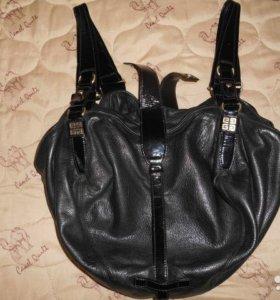 Черная кожаная сумка Живанши оригинал,с номером