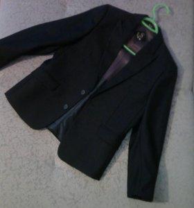 Пиджак новый для ребенка 9-10 лет