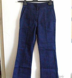 джинсы клеши