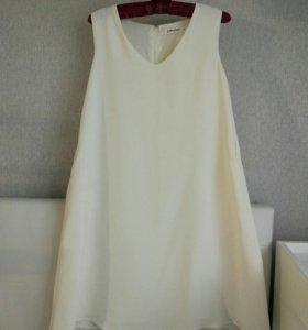 Трапецевидное платье с втачными карманами