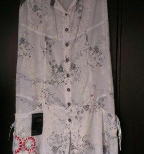 Блузка белая.