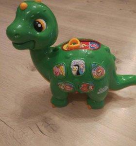 Игрушка динозавр .