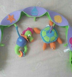 Дуга с игрушками на коляску