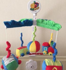 Музыкальная игрушка-карусель