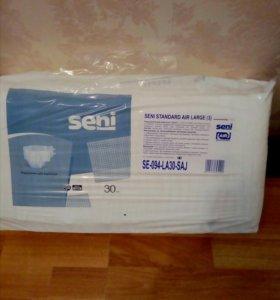 памперсы для взрослых, размер третий. 4 упаковки .