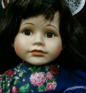 Кукла- девочка в синем
