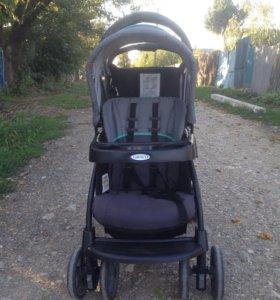 Детская коляска на двоих