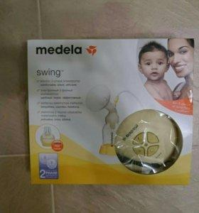 Молокоотсос medela swing електрический