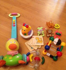 Каталка музыкальная, игрушки