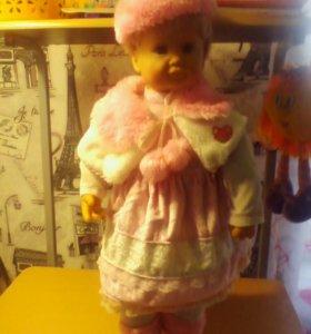 Большая интерактивная кукла отвечающая на вопросы.