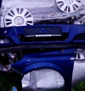 Оригинальный бампер Opel Astra H