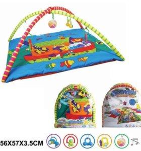 Развивающий коврик с игрушками на дугах