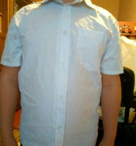 Продам недорого почти новую рубашку.на мальчика