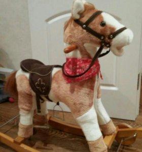 Лошадка-качалка с колесами