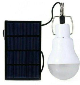 Светодиодная лампа с солнечной зарядной панелью.