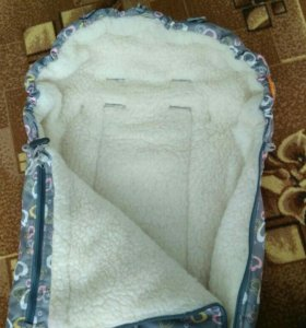 Зимний меховой конверт в коляску