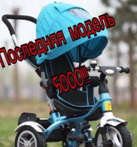 Трехколёсный велосипед с ручкой и поворотным сиден