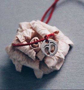 Нить красная (символ беременности, материнства)