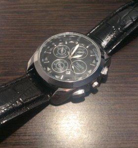 Tissot часы