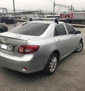 Багажник на крышу Thule Toyota Corolla E150