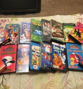 Кассеты с мультфильмами и кино  (на фото не все)