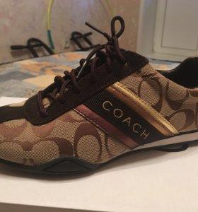 Кроссовки фирмы COACH