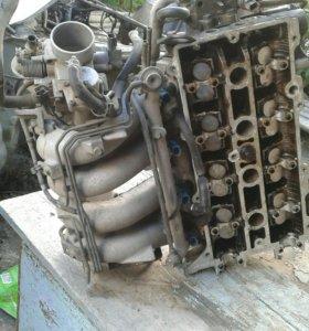 Плита в сборе головка клапанов инжектор Mazda 626