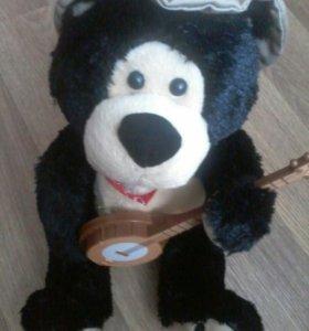 Игрушка поющий медведь