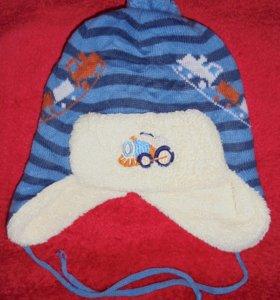 Продам зимнию шапку на 1-2 года