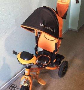 Велосипед трехколёсный с капюшоном