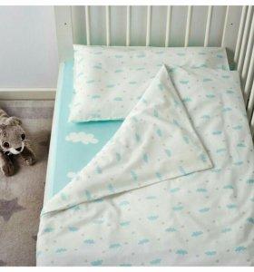 Новый детский комплект постельного белья.