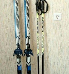 Лыжи + ботинки + палки + крепления.