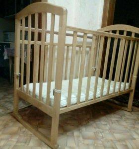 Детская кроватка-кочалка-маятник