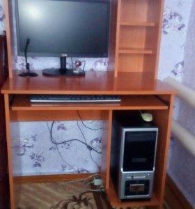 компьютерный стол и его принадлежности.