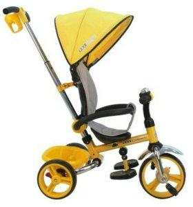 Велосипед детский. Яркий желтый трехколесный велос