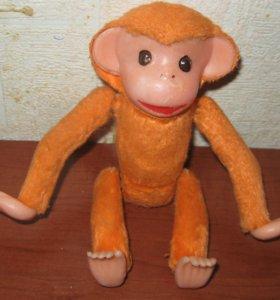 Игрушка заводная обезьянка