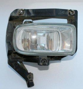 Фара противотуманная левая мазда демио 2000