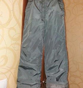 Новые утепленные брюки до 11 лет.