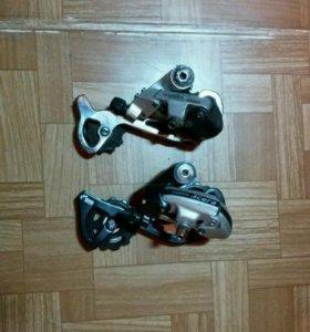 Задние переключатели Shimano M360 и MC18
