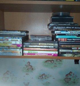 26 дисков с фильмами и мультики и 33 диска с игрми