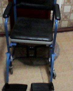 Инвалидное кресло каталка.