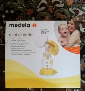 Молокоотсос Медела электрический