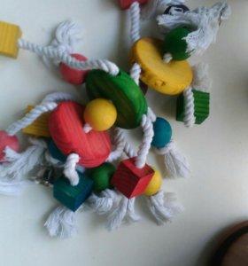 Игрушка для попугая