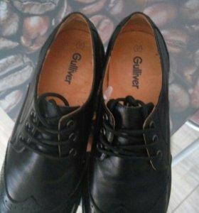Новые кожаные туфли.