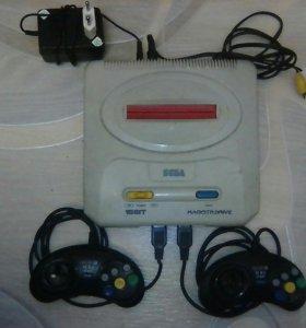 игровая приставка Sega с играми.