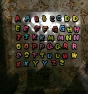 Стикеры в форме букв английского алфавита