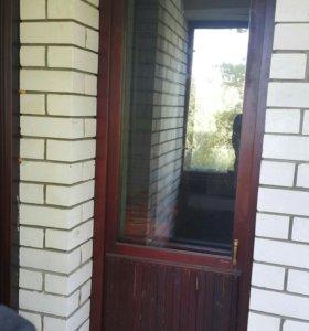 Дверь на балкон стеклопакет-дерево
