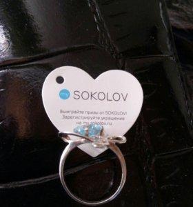 Кольцо серебряное с голубым топазом.