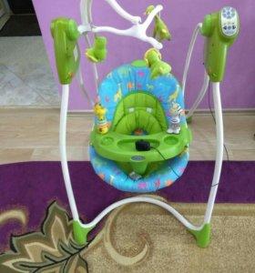Детские качели элек,авто кресло,ходунки,переноска.