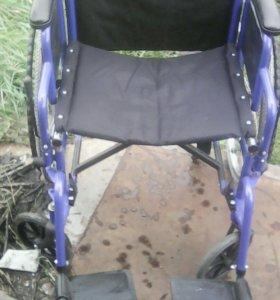 Инвалидная коляска .